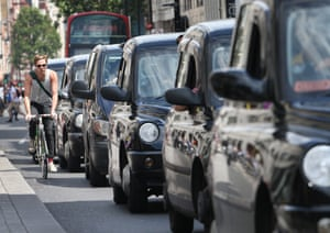 London cabs, fitted with diesel engines, line up along Oxford Street in London.