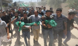 Palestinians carry the body of 3-year-old Mohammed Mnassrah during his funeral in the Maghazi refugee camp, central Gaza Strip, Thursday, July 10, 2014.