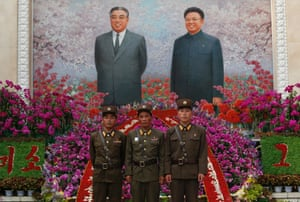 North Korean soldiers pose for a picture in front of portraits of the late leaders Kim Il-sung and Kim Jong-il in Pyongyang.