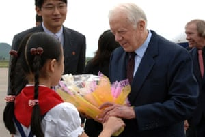 Jimmy Carter at Pyongyang airport on his return to North Korea in 2010 to secure the release of a jailed American.
