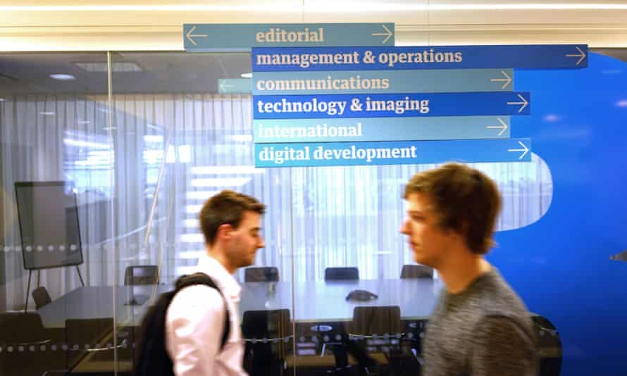 Guardian employees (Harry Slater and Daan Louter) make their way around the third floor of Kings Place.