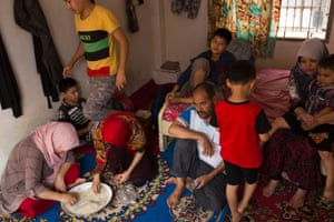 An extended family of ten Hazara asylum seekers from Afghanistan live together in a one room apartment in Cisarua, Indonesia