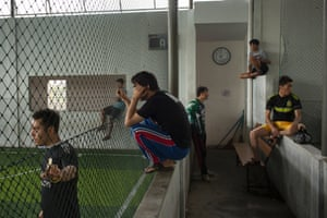 Hazara asylum seekers gather at the local grounds in Cisarua, Indonesia. Weekly games offer a welcome distraction from the difficulties of life in limbo.