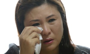 Won Jeong-hwa wipes a tear during an interview at her apartment in Gunpo, South Korea.