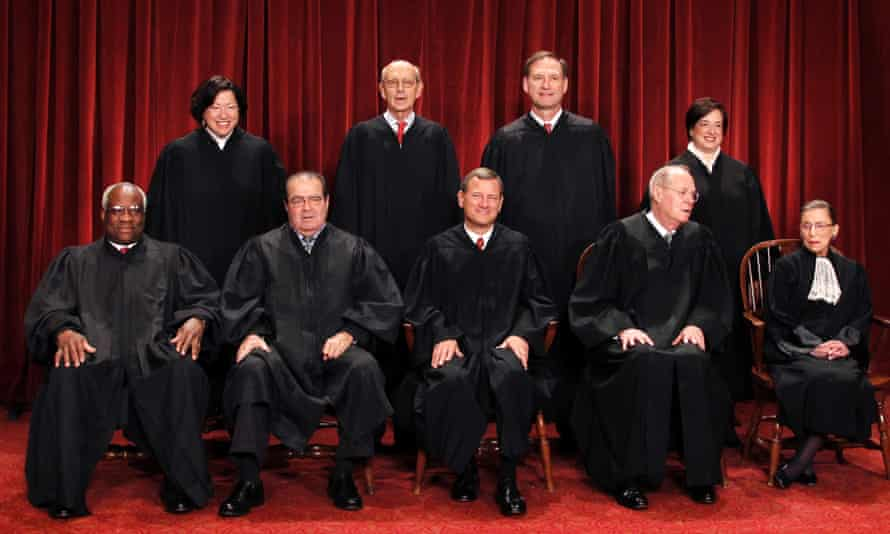 The Supreme Court justices pose for a group photo at the Supreme Court in Washington.