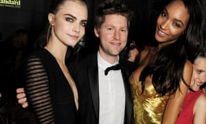 Burberry CEO Christopher Bailey, pictured with models Carla Delevigne and Jourdan Dunn. Bailey's £20m pay deal includes £460,000 for clothes and other items.