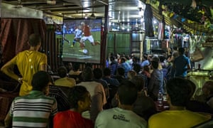 Egyptian fans watch Holland v Argentina in Cairo bar