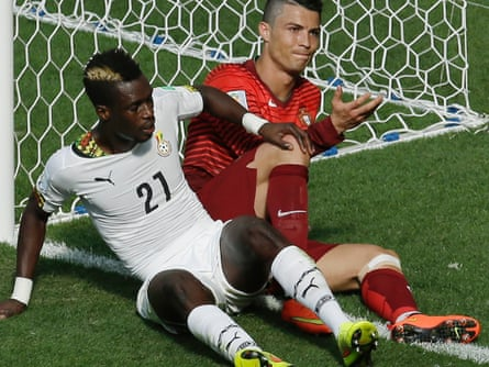 Ghana's John Boye and Cristiano Ronaldo during the group G match at the Estadio Nacional in Brasilia.