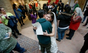 Jax and Heather Collins embrace after getting married at the Salt Lake County Clerk's Office in Utah.