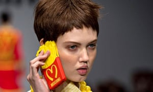Model Lindsey Wixson holds the Moschino iPhone case