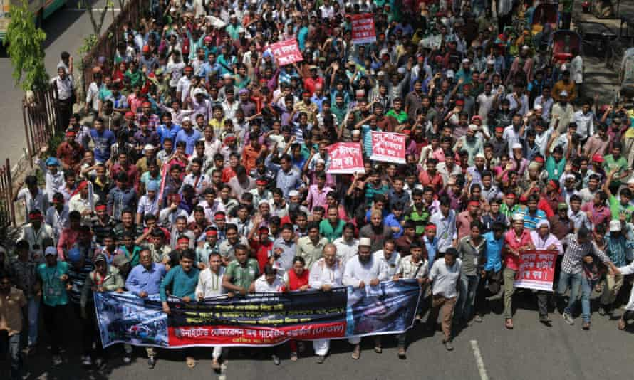 Garment workers take part in a rally demanding compensation for victims of Rana Plaza