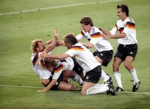 1990 world cup final: West Germany's Andreas Brehme is mobbed by his teammates.