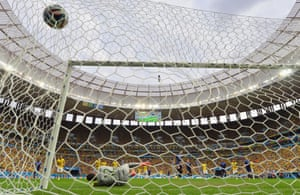 Holland's Robin van Persie hits the net to score his team's first goal from the penalty spot.