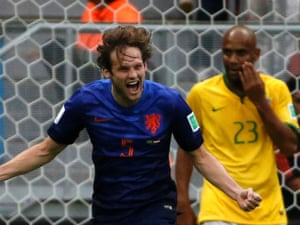 Daley Blind celebrates Hollands second goal as Brazil look blank with shock again.