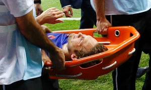 Daley Blind of the Netherlands is carried off the pitch after being injured.
