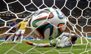 Brazil's goalkeeper Julio Cesar fails to save midfielder Georginio Wijnaldum's goal.