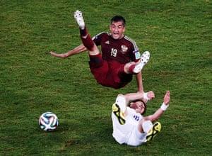 Best of the World Cup.: South Korea's Ki fouls Russia's Samedov