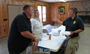Latta police chief Crystal Moore talks with friends at a fundraiser for a youth softball team.