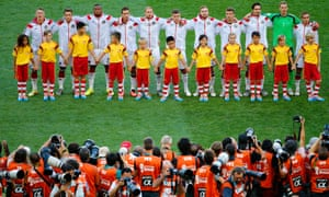 The German players line up on the pitch ready for their National Anthem.