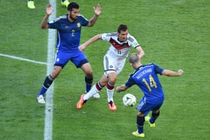 The Germans start brightly, here's Miroslav Klose tussling with Javier Mascherano in the Argentina area