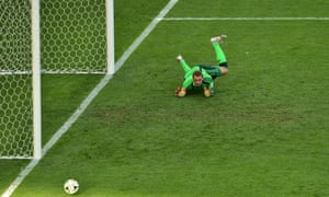 A relieved Manuel Neuer watches the ball go past his upright.