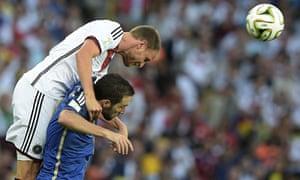 The Germany defender Benedikt Höewedes rises above the Argentina forward Gonzalo Higuaín