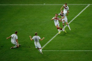footy.: Germany's forward Mario Goetze (C) celebrate
