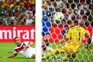 Mario Goetze watches the ball fly past Romero.