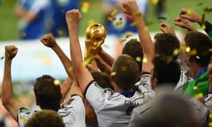 Germany's players hold the World Cup trophy aloft.