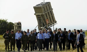 Israeli Prime Minister Benjamin Netanyahu  walks with troops during a visit to the area where Israel has deployed the Iron Dome short-range defence system near the southern city of Ashkelon in April  2011