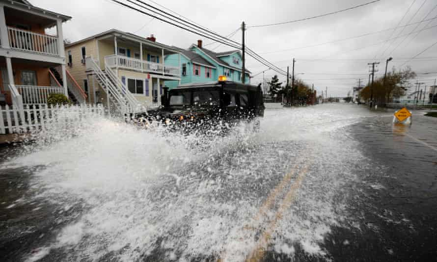 A National Guard humvee travels through high water after Hurricane Sandy