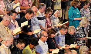 Members of the Church of England's Synod join in morning prayers
