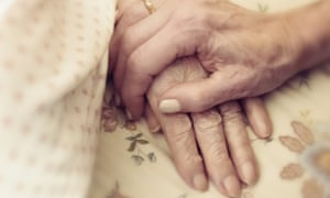 holding the hand of an elderly person