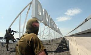 Pro-Russian militants on the roof of the international airport of the eastern Ukrainian city of Donetsk on 26 May, 2014.