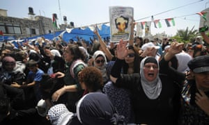 Palestinians attend the funeral of 16-year-old Mohammed Abu Khdeir in Jerusalem on 4 July.