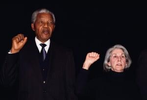 Nelson Mandela and author Nadine Gordimer sing National Liberation Anthem at Ghandi Memorial