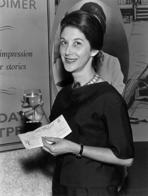 Novelist Nadine Gordimer at a Savoy literary luncheon, holding a cheque from booksellers W H Smith for £1,000.