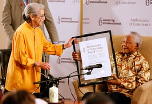 Former South African President and Nobel Peace Laureate Nelson Mandela smiling as he receives the Amnesty International Ambassador of Conscience Award from Nobel Literature Laureate Nadine Gordimer.