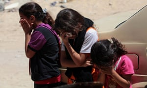 Palestinian girls mourn at their home before the funeral of their uncle, Adham Abed el-Al, who died the day before in an Israeli airstrike.