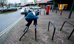 Child playing outside Sainsbury's