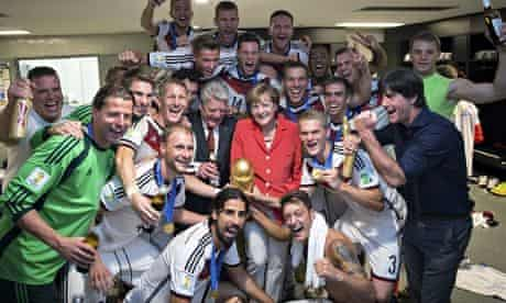 Angela Merkel with the German World Cup-winning team in the changing room