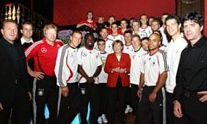 German Chancellor Angela Merkel poses with the German national team