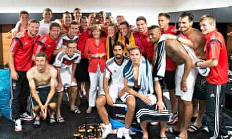 Angela Merkel poses with German team after Portugal win
