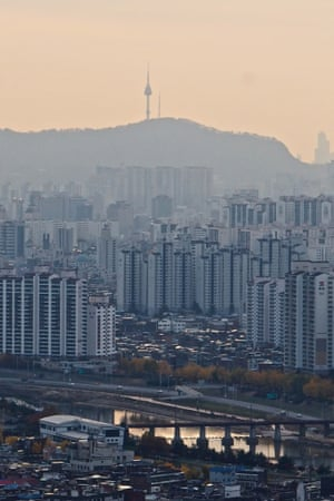 3 Bonghwasan (Bonghwasan) – A view across the city from Bonghwa Mountain, with Nam Mountain and N Seoul Tower in the distance. Copy-and-paste apartment towers are a legacy of the population boom and development push after the Korean War.
