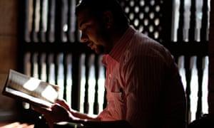 A Muslim man reads at al-Azhar mosque in Cairo