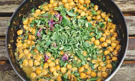 yotam ottolenghi's Chickpea stew withwet garlic, sageflowers and broad bean tops