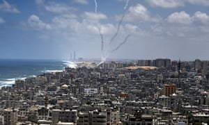 Smoke trails of rockets fired from near Gaza City towards Israel