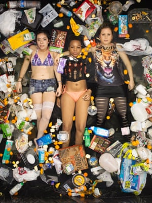 Lya, Whitney and Kathrin surrounded by seven days of their own rubbish in Pasadena, California