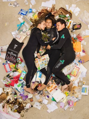 Susan, Curtis and Brittany surrounded by seven days of their own rubbish in Pasadena, California.