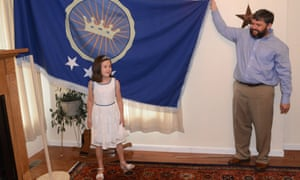 Jeremiah Heaton and his seven year-old daughter Emily, with the flag their family designed.